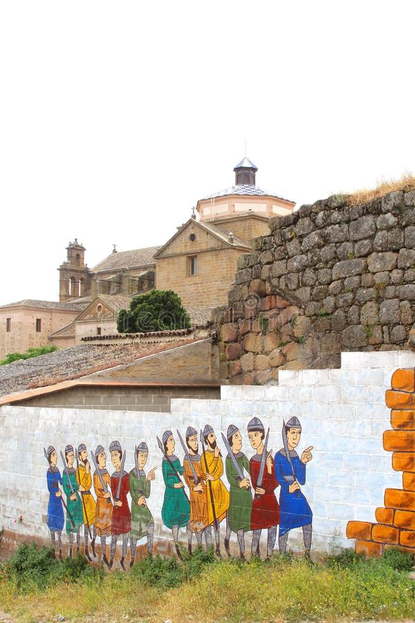 Modern street art and an ancient church in Oropesa,Spain. Urban street art with knights and an ancient church in Oropesa,province Toledo, Castilla La Mancha ( royalty free stock images