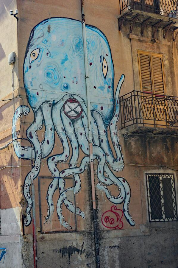 Street Art in Palermo Sicily - A pale blue octopus. In the Borgo Vecchio near the port is the outside car park for the Hotel ibis Styles Palermo President. The stock photos