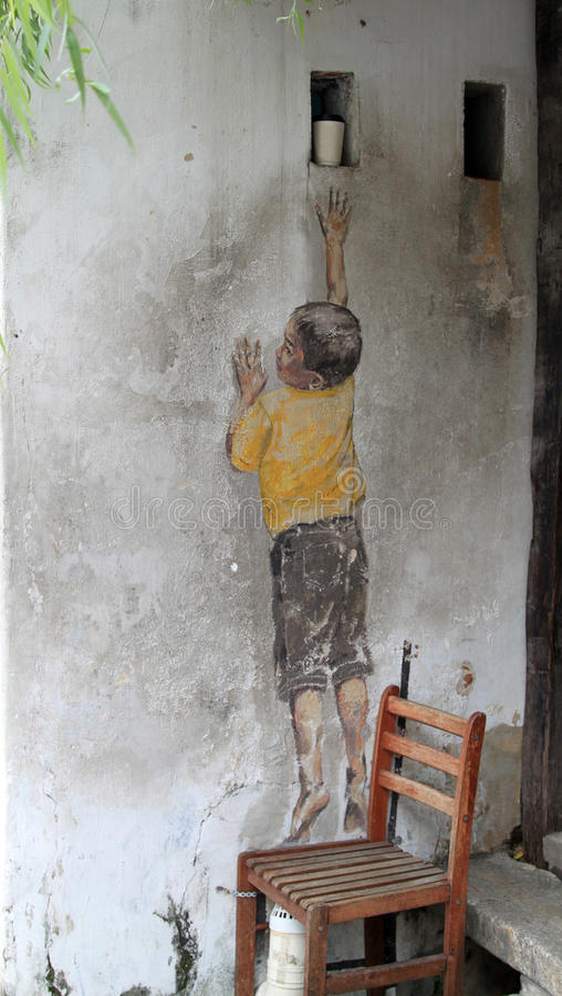Street Art at Penang, Boy on Chair stock image