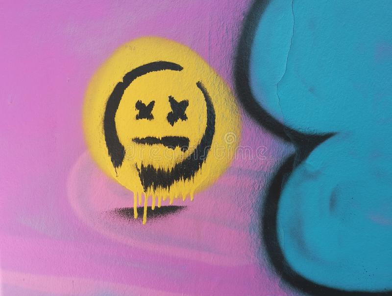 Street art, smiley face. Wit x eyes royalty free stock photo