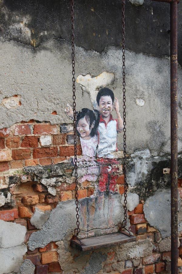 Street art swing royalty free stock photo