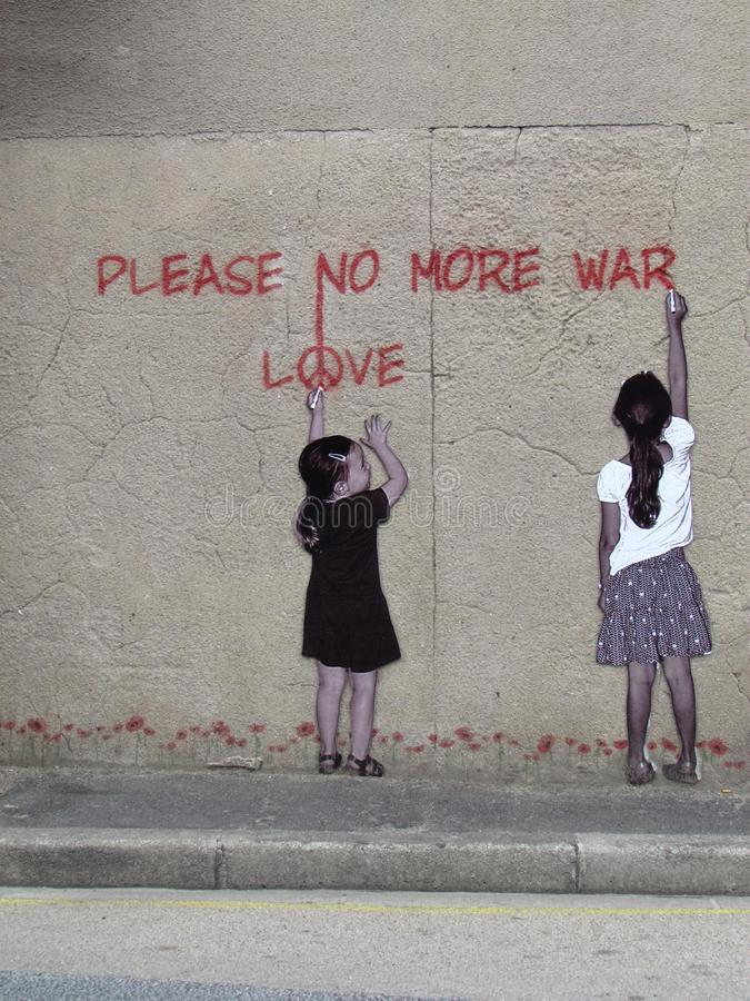 Street art with two girls writing Please no more war royalty free stock images