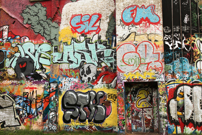 Street art wall. Wall painted with street art and graffiti (in a designated street art area in Antwerp, Belgium royalty free stock photos