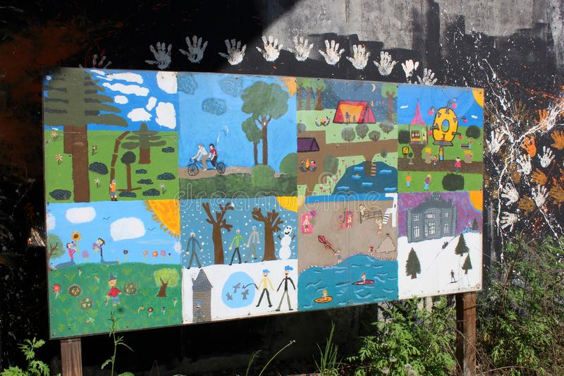 Street art done by children in the neighborhood, with images of peace, family, and getting along, Gardner, Maine, 2019 stock photo
