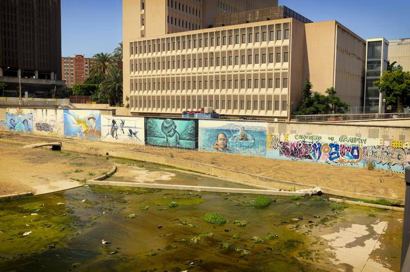 Street Art on the walls of the waterway. Street Art lines the dried out waterway in the centre of Malaga, Spain royalty free stock photo