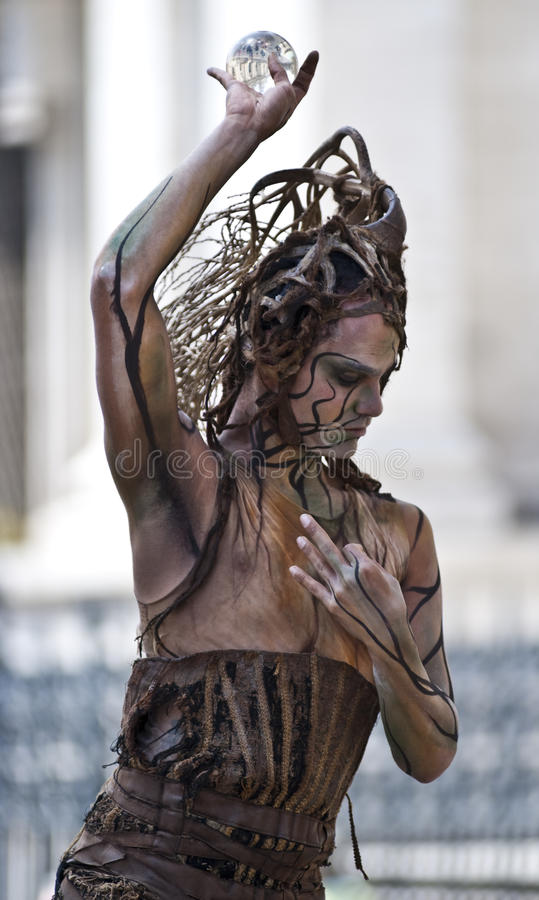 Street artist. Performing in Piazza Navona (Rome). You can see the monuments reflected in the ball stock photography