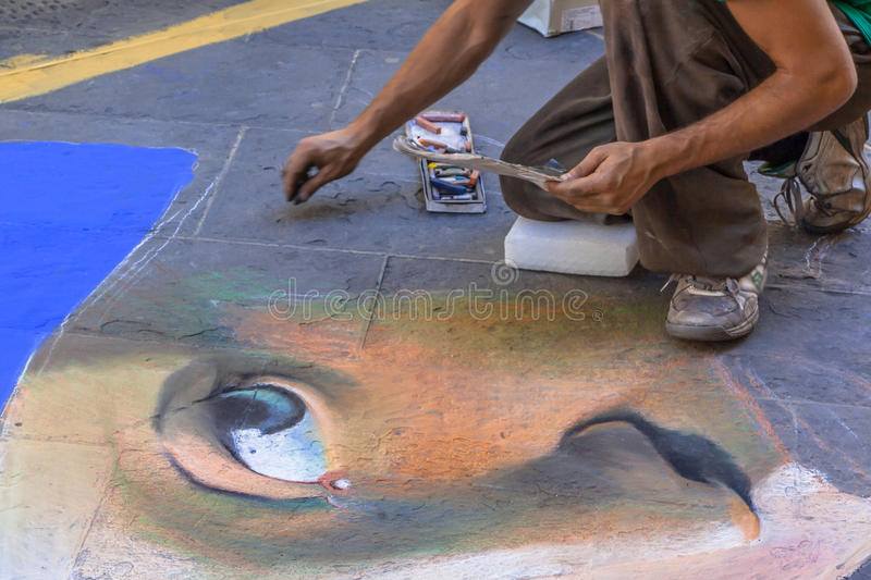 Street Artist. Drawing a Portrait on the Pavement stock image