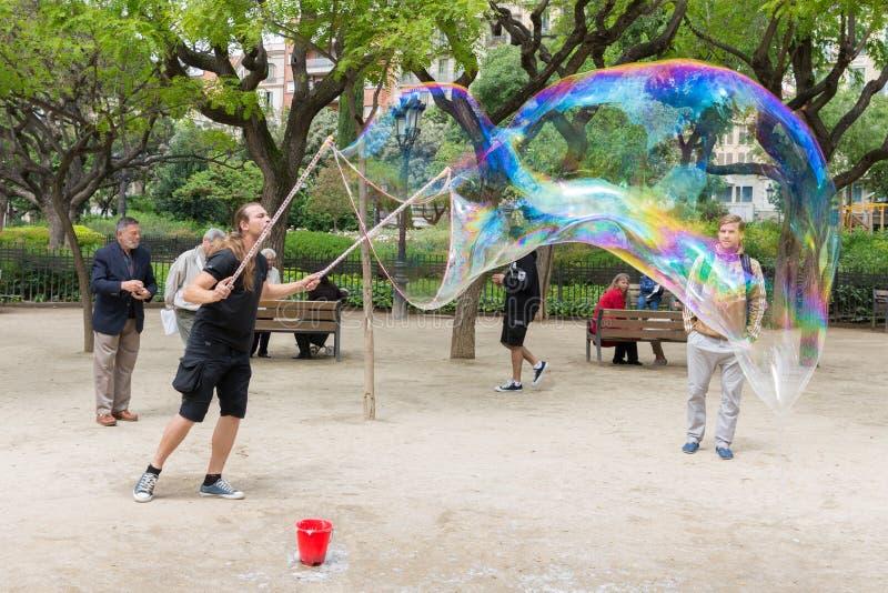 Street artist makes big soap bubbles stock photos