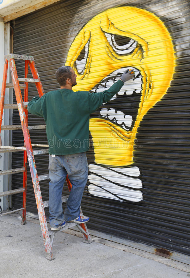 Street artist painting mural at Williamsburg in Brooklyn royalty free stock images