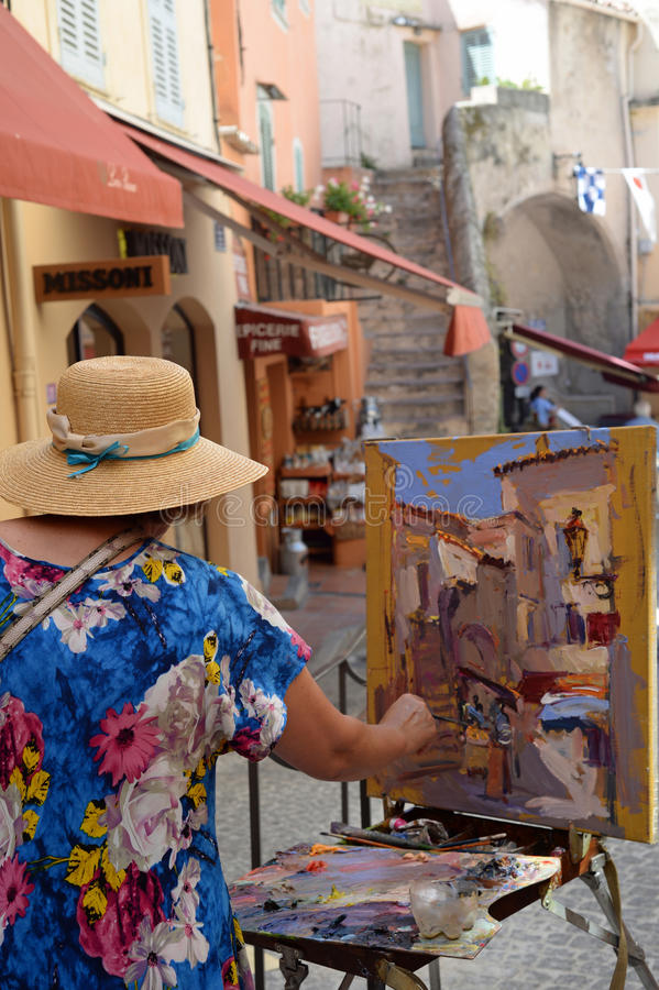 Street artist painting royalty free stock images