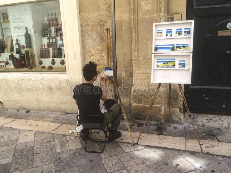 Street artist, paints picture in the streets of Lecce Puglia-Italy royalty free stock images