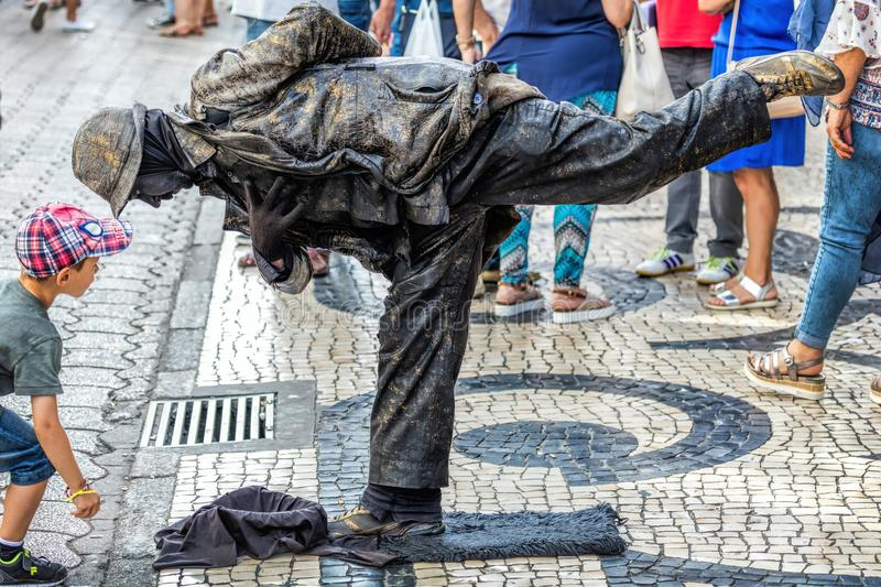 Street artist performing as a `living statue` stock image
