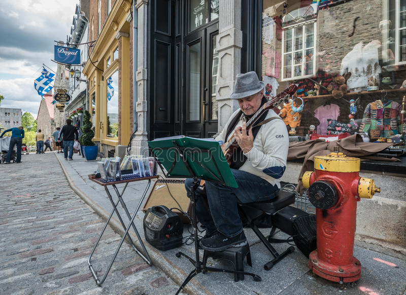 Street artist of Quebec City performing. QUEBEC CITY, QUEBEC, CANADA - JULY 21: Street artist of Quebec City performing, in Quebec City, Quebec, Canada, on July royalty free stock photography