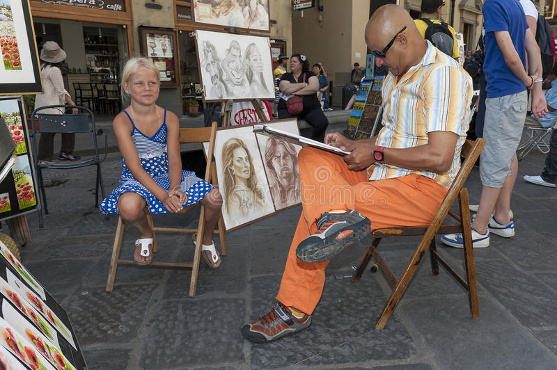 Street artist. Talented comic street artist in Italy is drawing a young girl royalty free stock photos