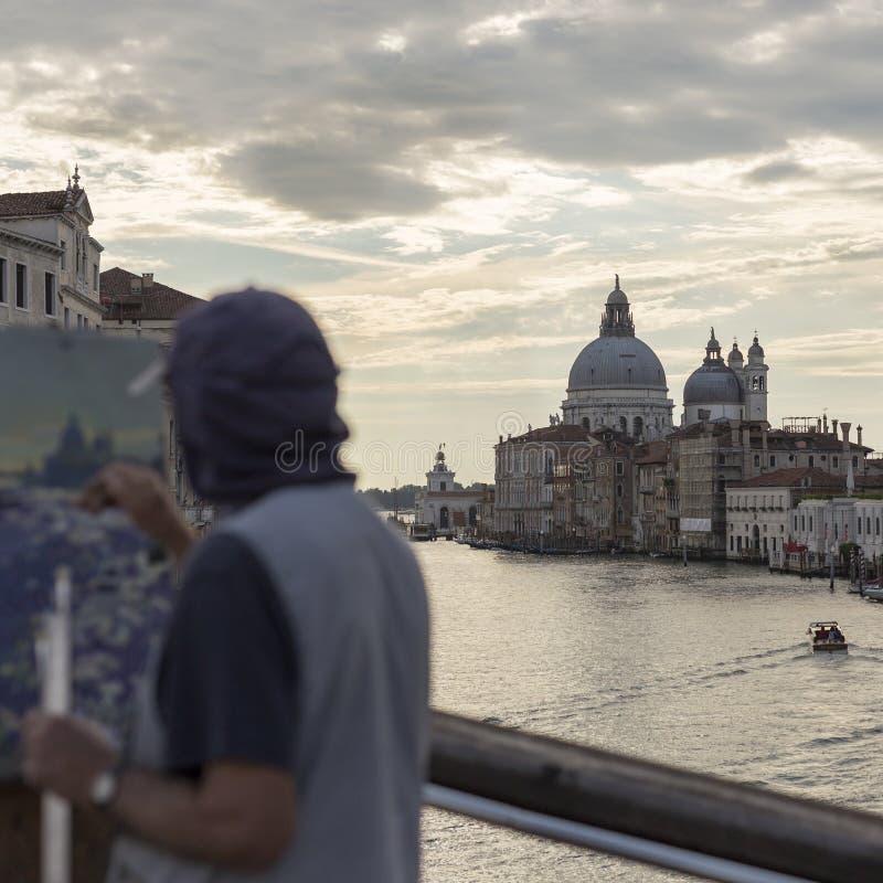 Street artist. Venice street artist on the bridge royalty free stock photography