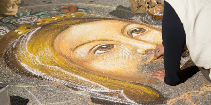 Street artist who paints Jesus. Street artist who paints the face of Jesus stock photography
