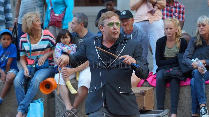 Street artists perform in front of the audience on a street in downtown Ottawa. stock photos