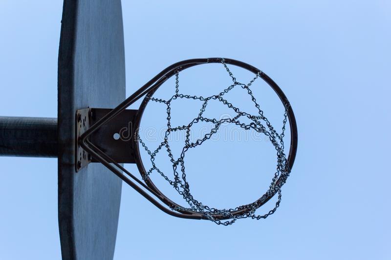 Street ball. Looking up at a street ball hoop stock photography