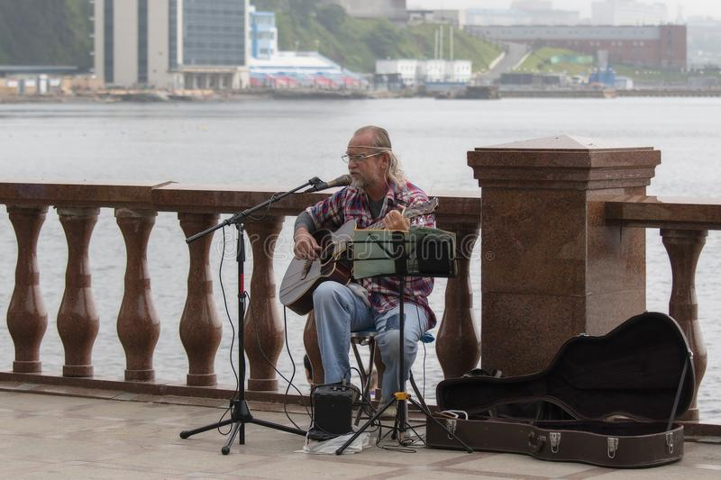 Street bard performs songs stock photo