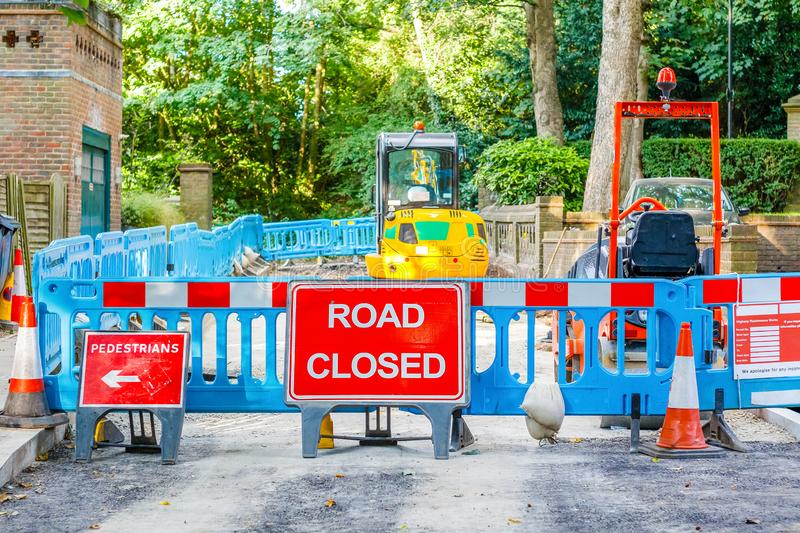 Street barricaded with ROAD CLOSED signs. Due to road maintenance in London royalty free stock image