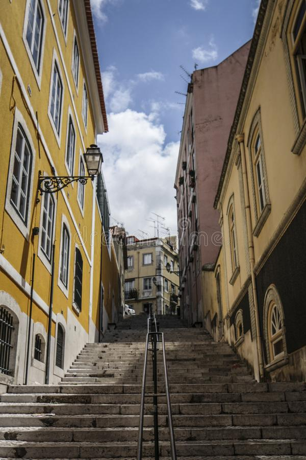 Street in Barrio Alto Lisbon. A street with stairs and colorful houses in iconic Barrio Alto a night life neighbourhood of Lisbon during the day stock photos