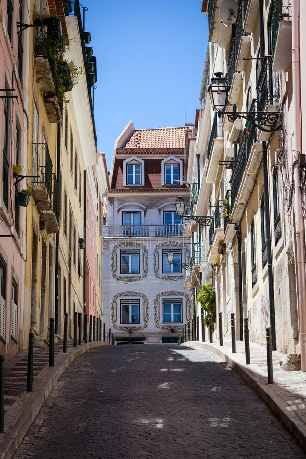 Street in Barrio Alto Lisbon. A street with a view of a house with azulejos in iconic Barrio Alto a night life neighbourhood of Lisbon during the day royalty free stock image