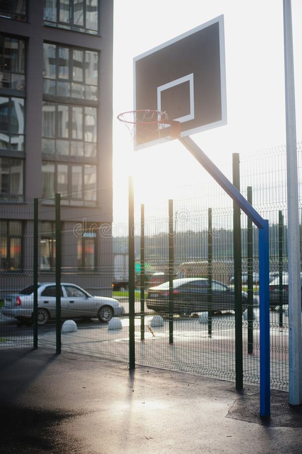 Street basketball court. And basketball Hoop on sunset background royalty free stock images