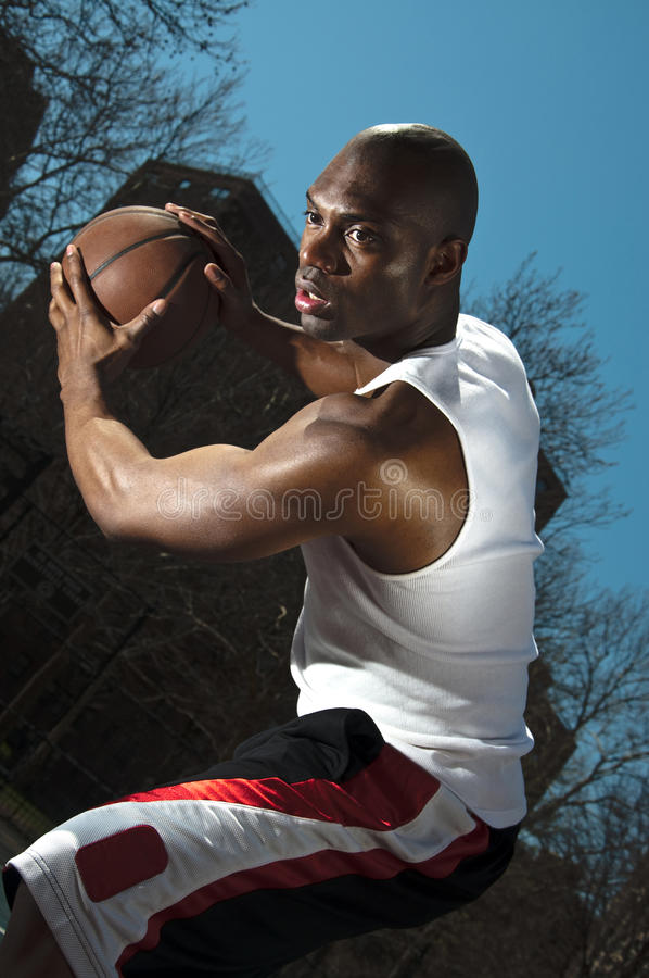 Street Basketball Player Guarding Ball Stock Image
