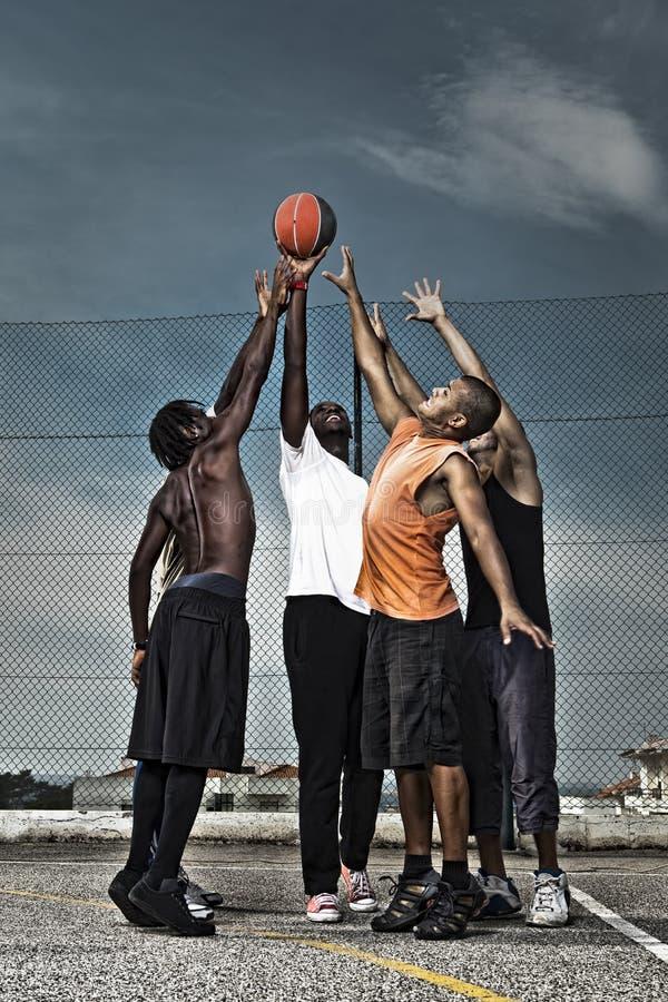 Street basketball team. Group portrait of a street basketball team royalty free stock photos