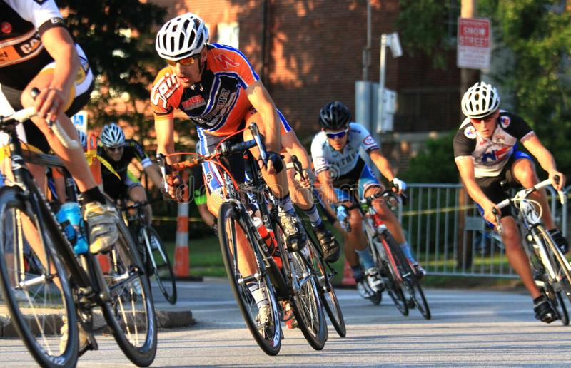 Street bike race event. Pro bike riders make the turn on the race tour at the urban professional Criterium bicycle race in the city streets, USA Cycling event stock photo