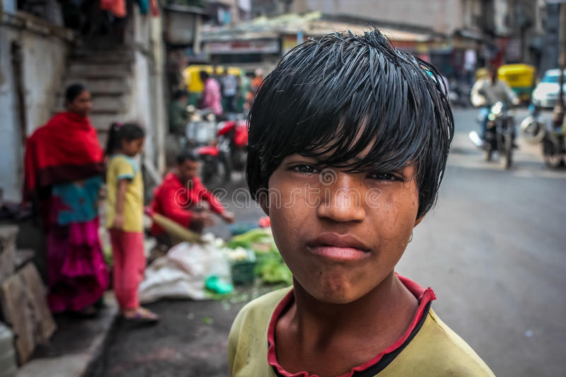Street Boy. Street of Mumbai working on streets and selling fruits and vegetables stock image