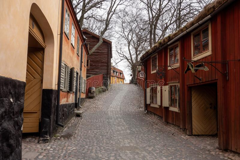 The street and buildings in the famous Skansen Museum in Stockholm which was the first one in the world with a generic Krog sign. In the backgournd which means royalty free stock photos