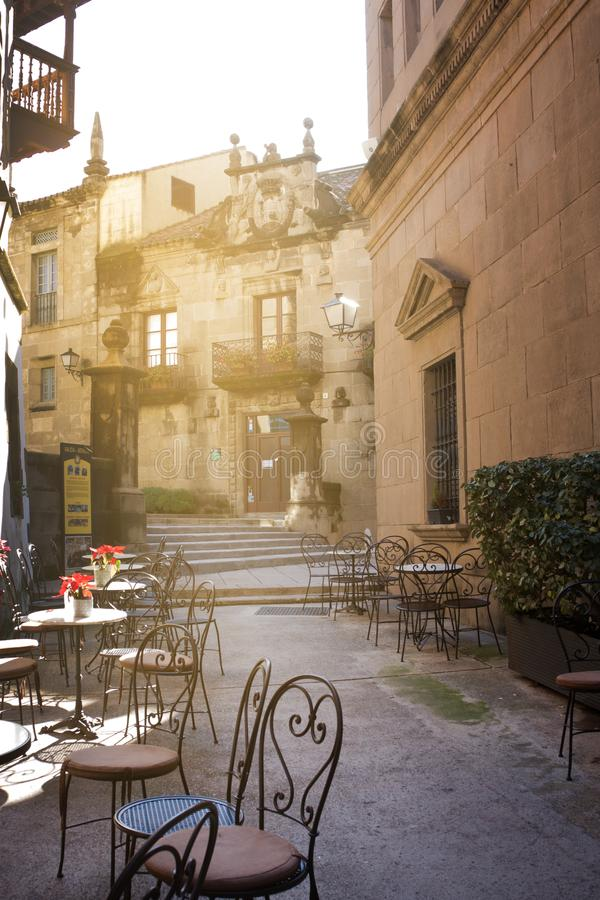 Street cafe with metal tables and chairs in Barcelona, Spain royalty free stock photography