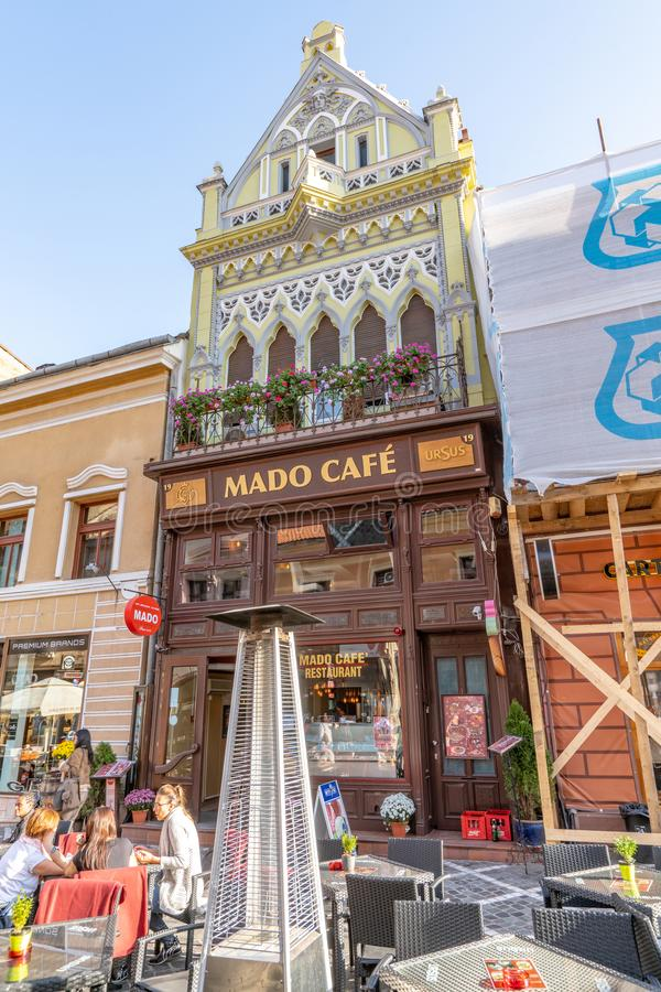 Street Cafe in the old Brasov, Romania. One of the ten largest cities in Romania. Located in the heart of Romania, the city of Brasov is sometimes called the royalty free stock photo