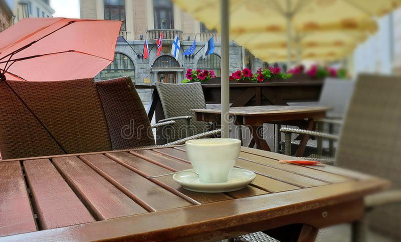 Street Cafe Table on top cup of coffee breakfast  and on chair pink umbrella. Street Cafe Table on top cup of coffee,morning breakfast , and on chair pink royalty free stock photography