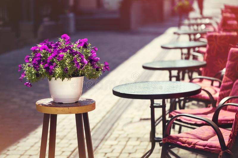 Street cafe tables in downtown on a summer day royalty free stock photos