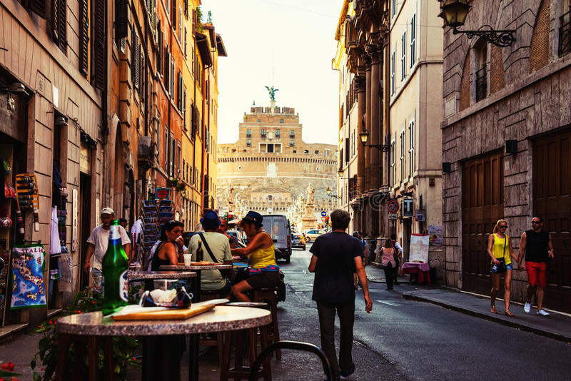 Street cafe with tourists, city life in the center of Rome, Italy stock photos
