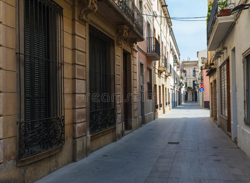 Street in Calella in Catalonia, Spain near Barcelona. Scenic old town with sand beach and clear blue water. Famous tourist stock photo