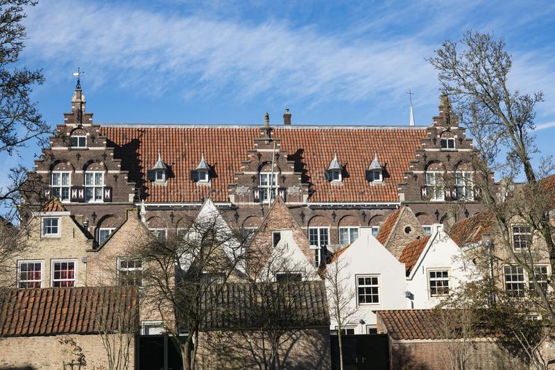 Street called Kloostertuin with monumental buildings in Dordrecht, The Netherlands. Monumental buildings, houses and old school in street Kloostertuinen in royalty free stock image