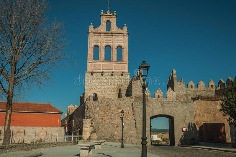 Street at the Carmen Gateway on the city wall of Avila. Street going through the Carmen Gateway on the stone city wall and brick tower, in a sunny day at Avila stock photography