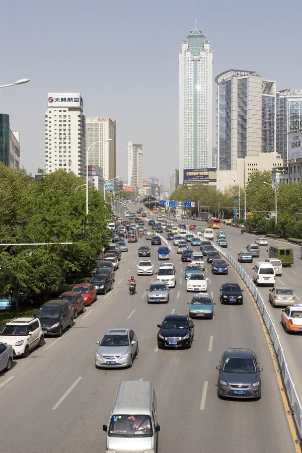 Street with cars in Wuhan of China. Street with lots of cars in Wuhan of China.Wuhan (simplified Chinese: 武汉) is the capital of Hubei province, People stock images