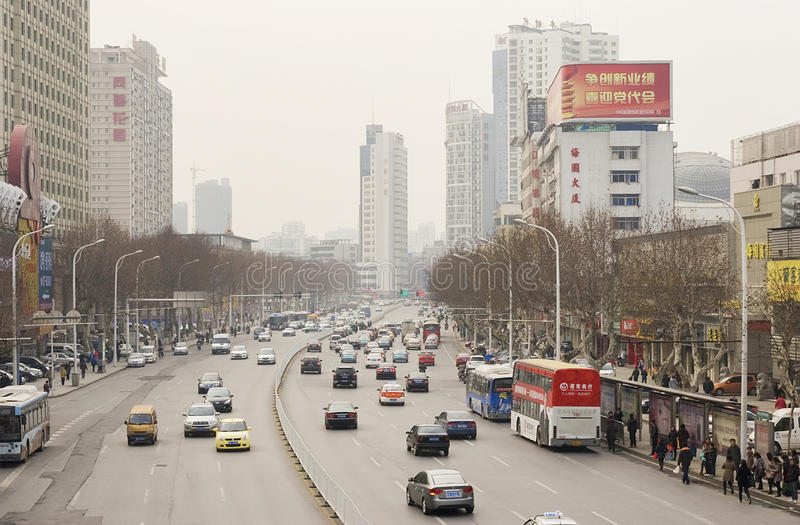 Street with cars in Wuhan of China. Street with lots of cars in Wuhan of China.Wuhan (simplified Chinese: 武汉) is the capital of Hubei province, People stock photography