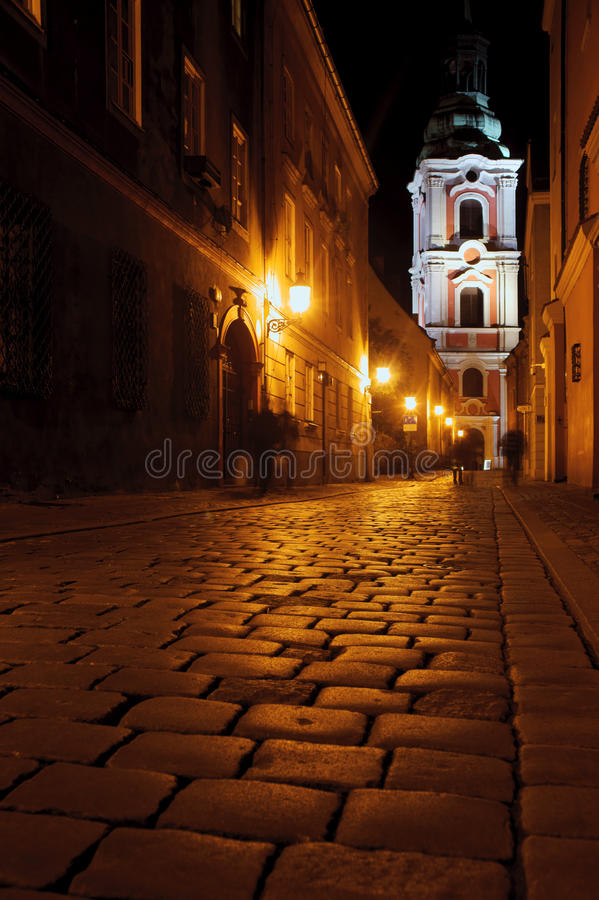 Street With Church By Night In Poznan Royalty Free Stock Photos