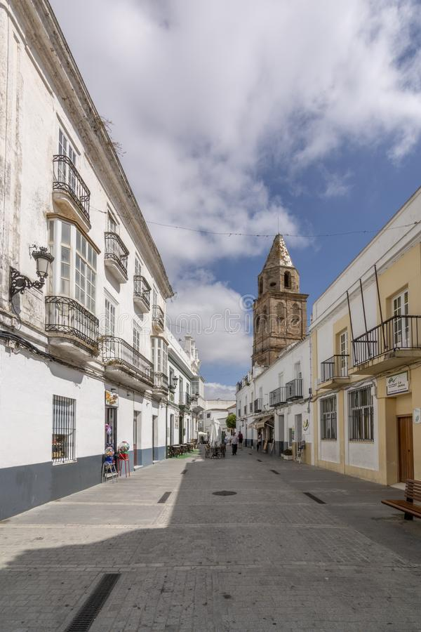 A street with the church tower in the background of Medina Sidonia, Spain. royalty free stock photos