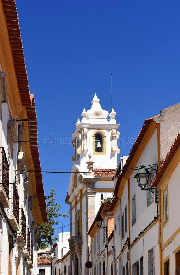 Street and church in the village of Alter Do Chao, Beiras region.  royalty free stock image