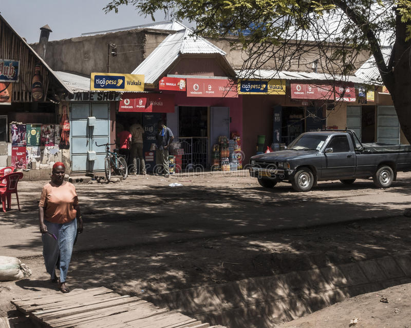 Street in city in Africa. A street with scops and people in The Arusha city in Africa , Tanzania stock image