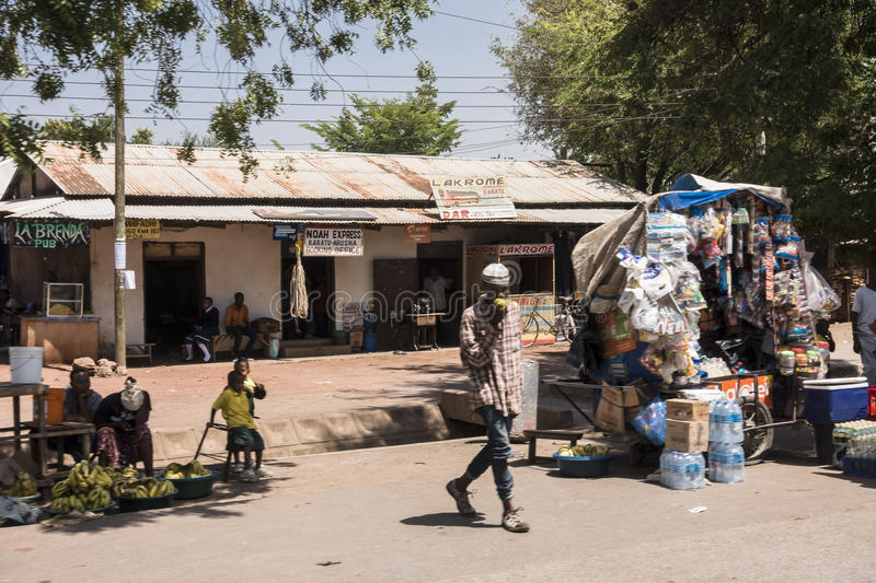 Street in city in Africa. A street with scops and people in The Arusha city in Africa , Tanzania stock photos