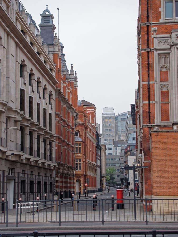 Street in the city center of London UK. Street in the city center of London in UK. Mixed media royalty free stock photo