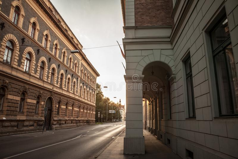 Street of the city center of Szeged, Southern Hungary, surrounded with buildings from the 19th century, Austro Hungary style. Picture of a street of the city stock images