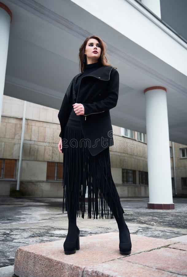 Street city fashion: portrait of pretty young girl in black stock photography